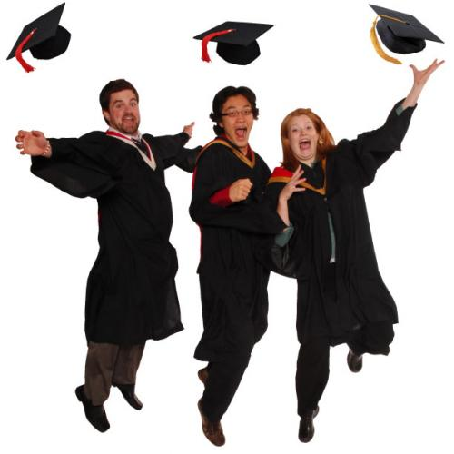 Photo of  excited students jumping in their graduation robes throwing their caps