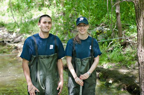A male and female Environmental Sciences students in their work environment