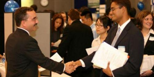 Two males shaking hands at a Job Fair